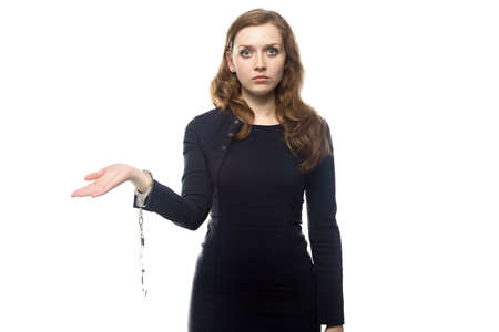 intimidated: Woman with handcuffs, isolated on white background