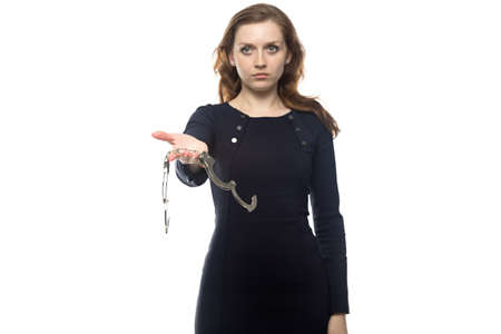 woman handcuffs: Young woman with handcuffs, isolated on white background Stock Photo