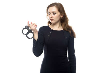 woman handcuffs: Thinking woman with handcuffs, isolated on white background
