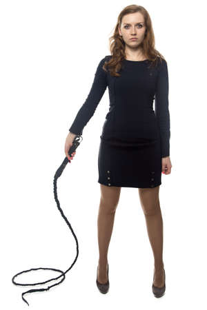 Serious woman with whip, isolated on white background