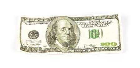 scrunch: Crumpled hundred dollars, photo on white background Stock Photo