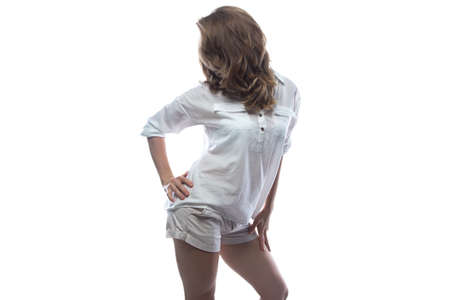 turn away: Turned away blond woman in casual shirt on white background