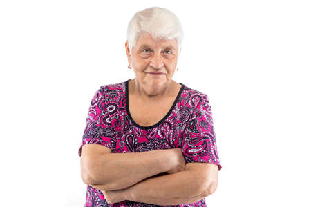 Elderly lady with arms crossed on white background