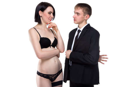 adultery: Married lying man and brunette woman on white background Stock Photo