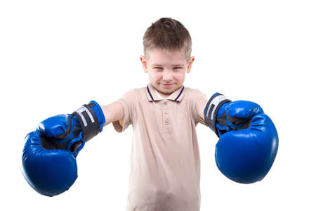 boxing boy: Little boy with boxing gloves on white background Stock Photo