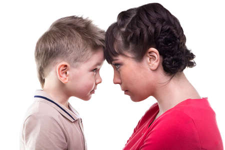 maternal: Brunette mother and blond son on white background
