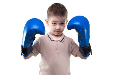 boxing boy: Cute serious little boy with boxing gloves on white background