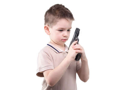 Little boy with the gun on white background