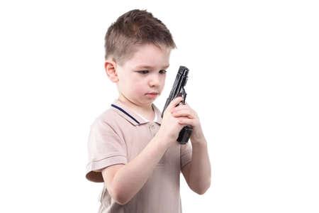 Little boy with the gun on white background