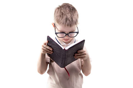 educated: Little educated boy reading book on white background