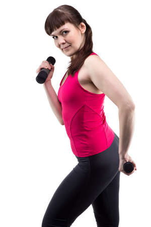 exertion: Brunette woman with dumbbells on white background Stock Photo