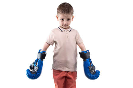 boy boxing: Cute little boy with boxing gloves on white background