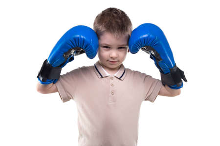 boxing boy: Cute blond little boy with boxing gloves on white background Stock Photo