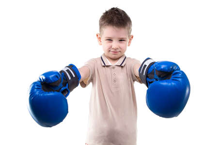 boxing boy: Smiling little boy and boxing gloves on white background