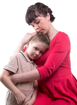 maternal: Hugging loving mother and her son on white background