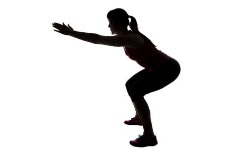 Silhouette of woman, squats on white background Stock Photo