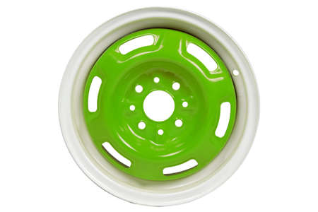 coating: Powder coating of green wheel disk on white background
