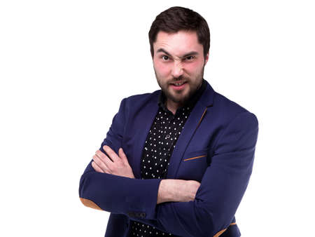 grimace: Bearded young man with grimace on white background