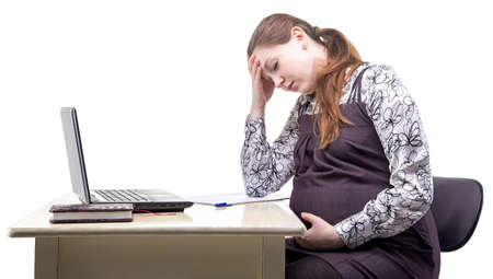 tired person: Tired pregnant woman in office on white background Stock Photo