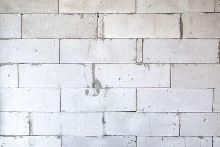 overhaul: Texture of a light brick wall during overhaul