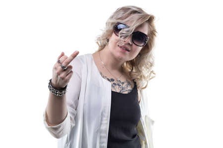 Blond woman with middle finger on white background