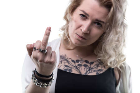 wicked problem: Blond woman showing middle finger on white background