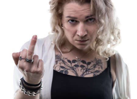 wicked problem: Blond angry woman showing middle finger on white background