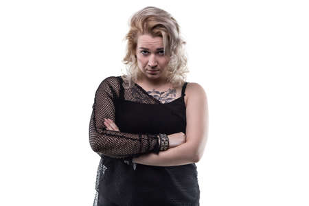 frowned: Frowned blond woman with arms crossed on white background
