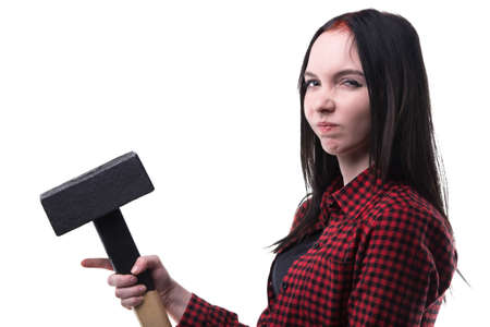 frowned: Frowned young brunette with big hammer on white background Stock Photo