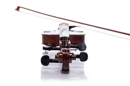 fiddles: Wooden brown fiddle with stick on white background