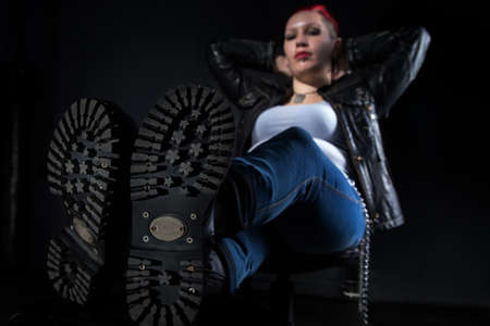 skinhead: Skinhead boots and sitting informal woman