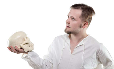 Blond man with human skull