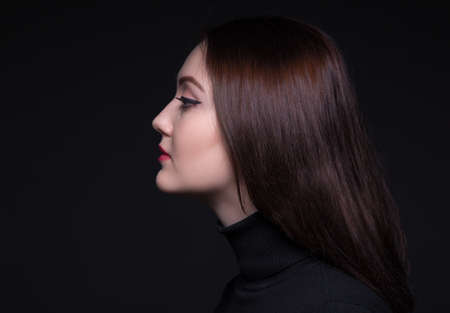 woman profile: Portrait of young woman in profile Stock Photo