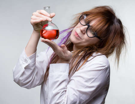 Scientist woman with red liquid