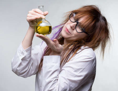 Scientist woman with yellow liquid