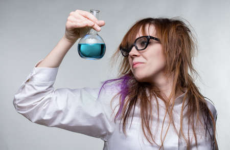Scientist shaggy woman with blue liquid