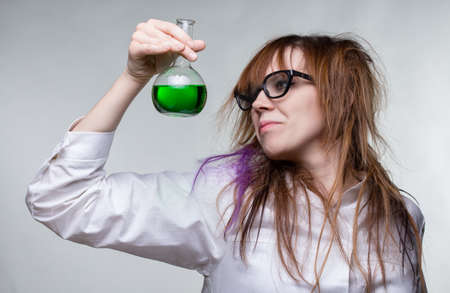 Scientist shaggy woman with green liquid