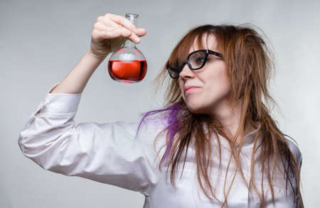 Scientist shaggy woman with red liquid