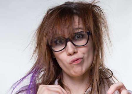 Grimacing scientist shaggy woman Imagens