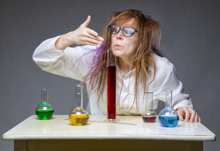 Sniffing shaggy chemist in lab Stock Photo
