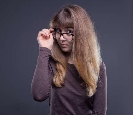 Teenage girl holding glasses Stock Photo