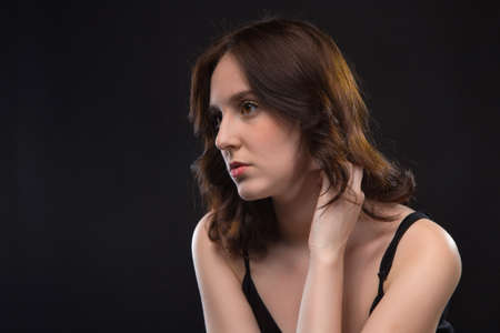 Portrait of wistful young brunette woman Stock Photo