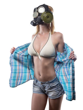 Young undressing woman in gas mask