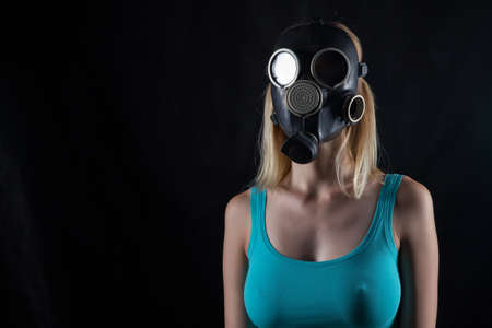 Portrait of woman in gas mask
