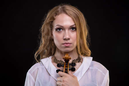 Young blond girl with fiddle