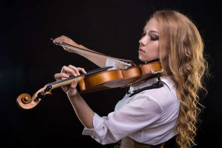 Young blond woman with violin Stock Photo