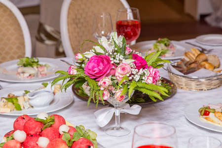 Decoration of banquet - flowers on table Stock Photo