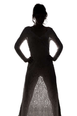 Girl in see-through dress with hands on hips