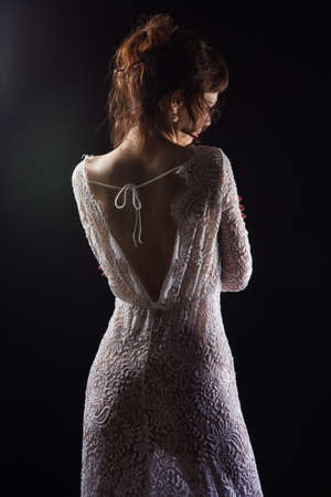 Girl in lace dress from back Stockfoto