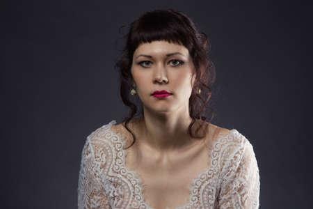 Portrait of woman in lace dress Stockfoto